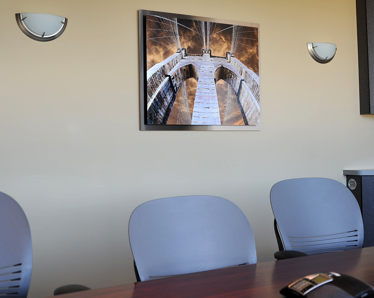 Brooklyn Bridge: Wired adorning Comply365's conference room.